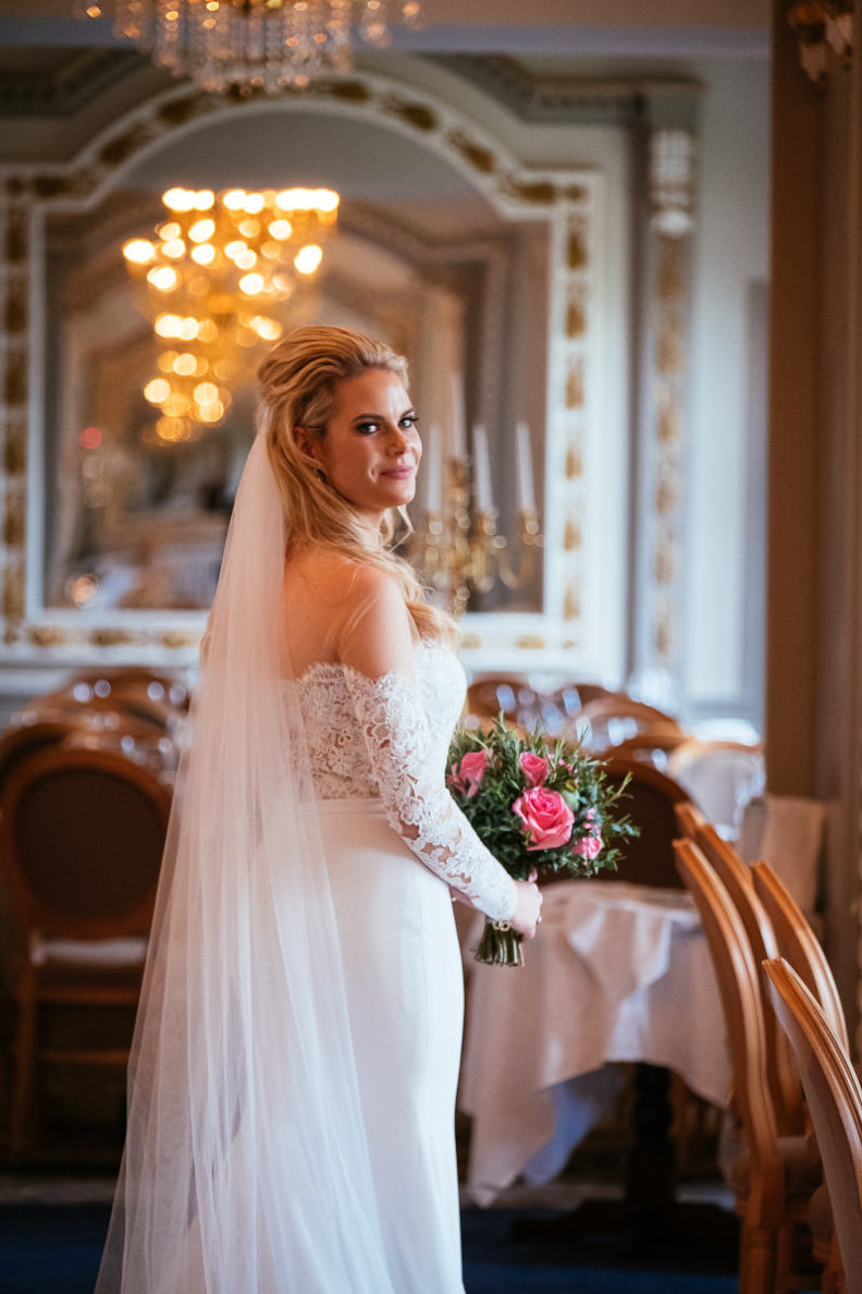 bride standing in the reception room of markree castle showing the back of her dress