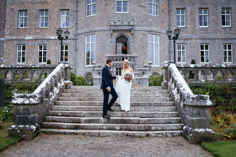 bride and groom walking down steps of markree castle
