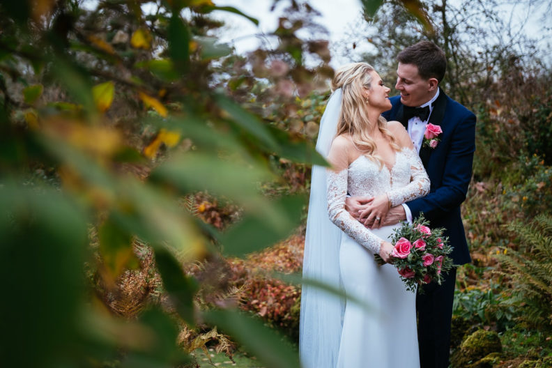bride and groom embracing in garden of markree castle