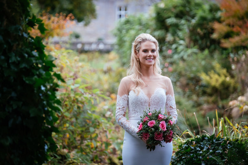 bride standing in garden of markree castle