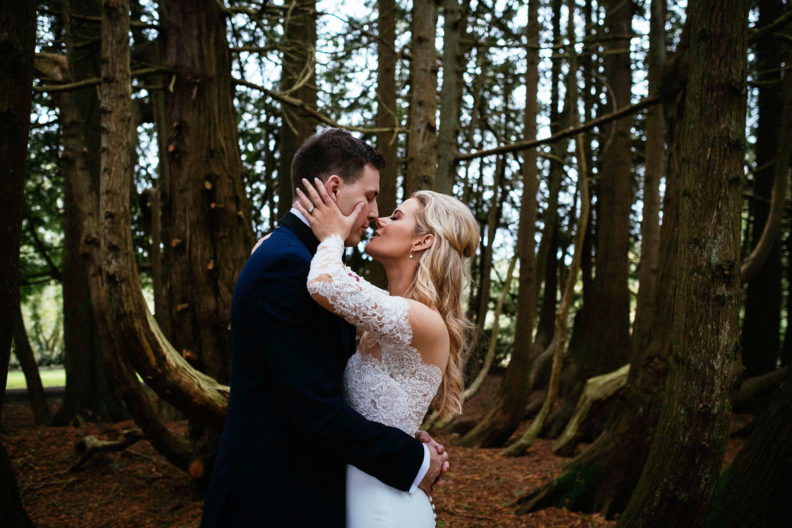 bride and groom kissing in the woods at markree castle