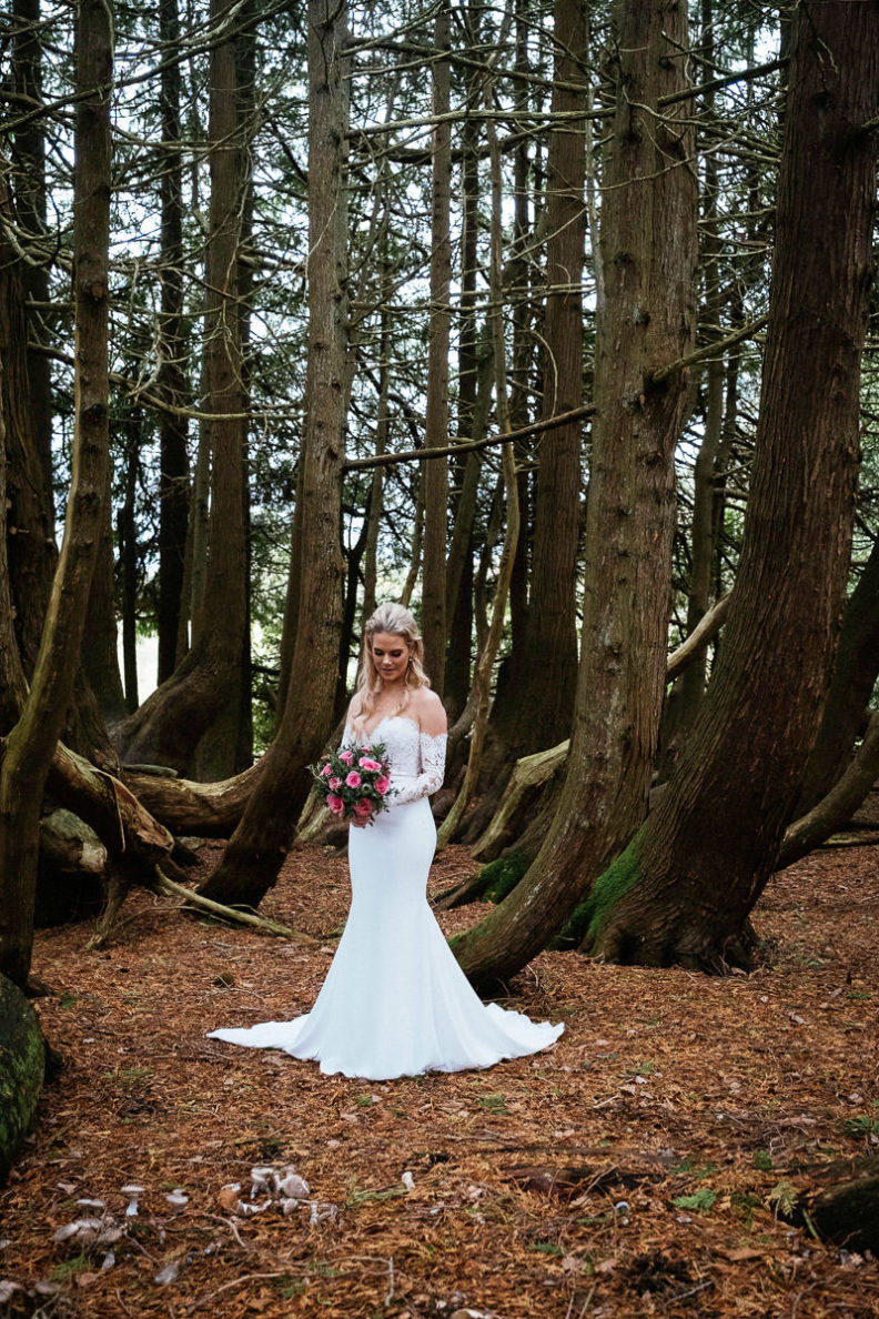 bride standing in woods of markree castle
