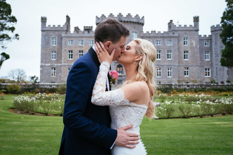 bride and groom kissing in front of markree castle