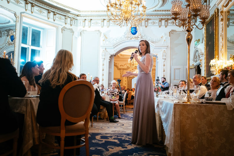 bridesmaid making a speech during wedding dinner