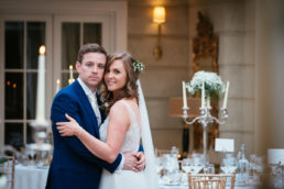 bride and groom embracing in reception room of tankardstown house