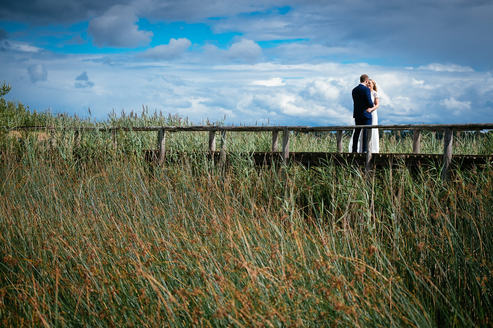 bride and groom kissing on a bridge at glasson house athlone