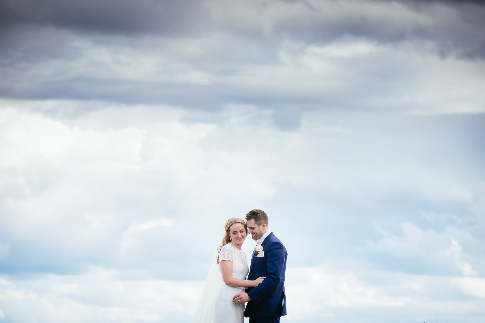 bride and groom embracing on a bridge at glasson house athlone