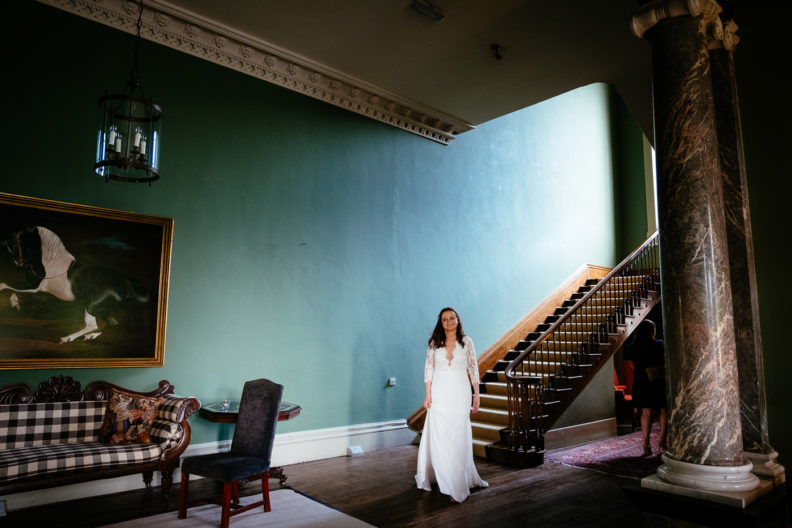 bride coming down a staircase