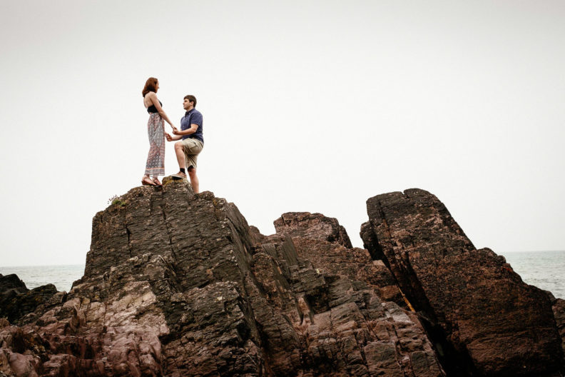 engaged couple holding hands on a cliff in ballycotton county cork ireland