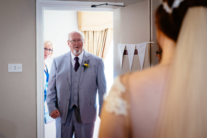 father seeing his daughter in a wedding dress for the first time