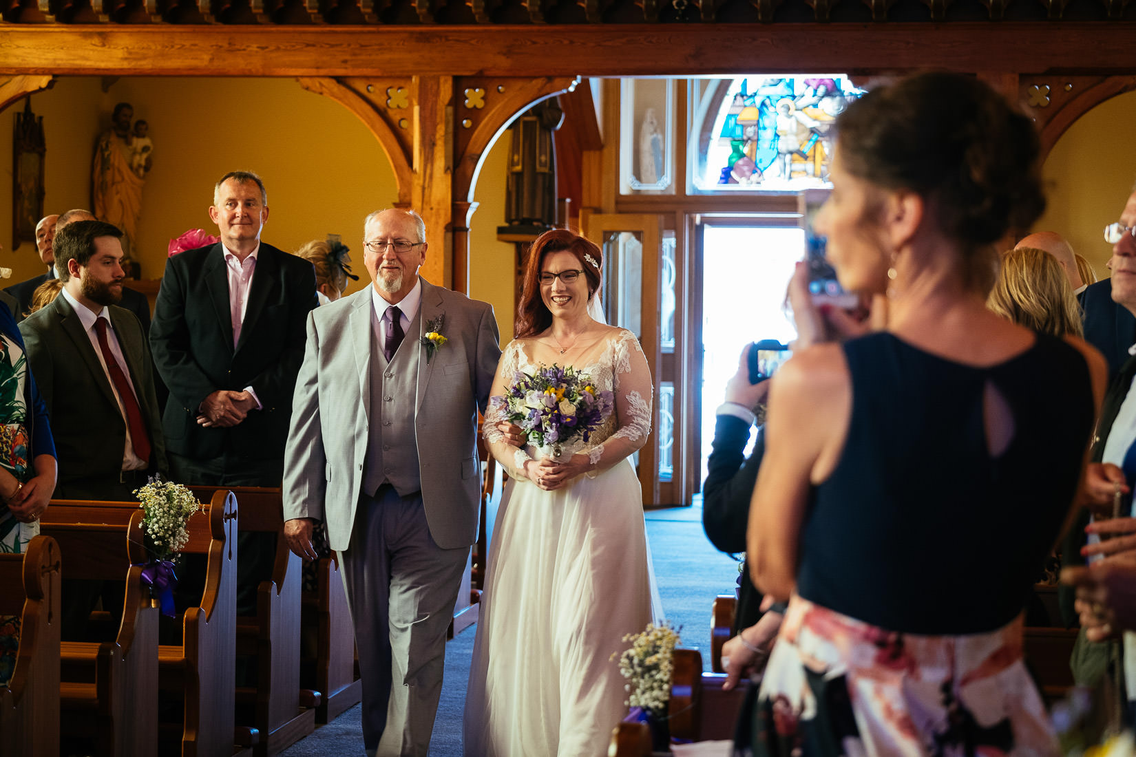bride and her dad walking up the aisle