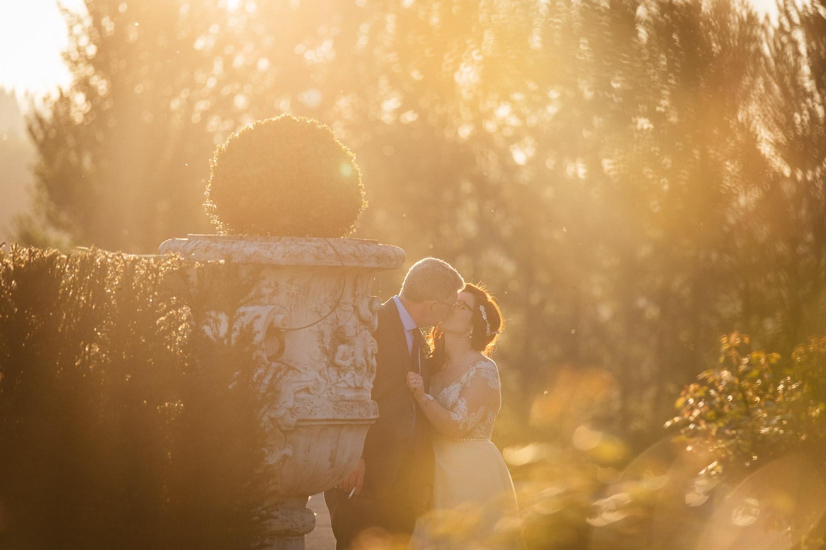 bride and groom kissing at cabra castle