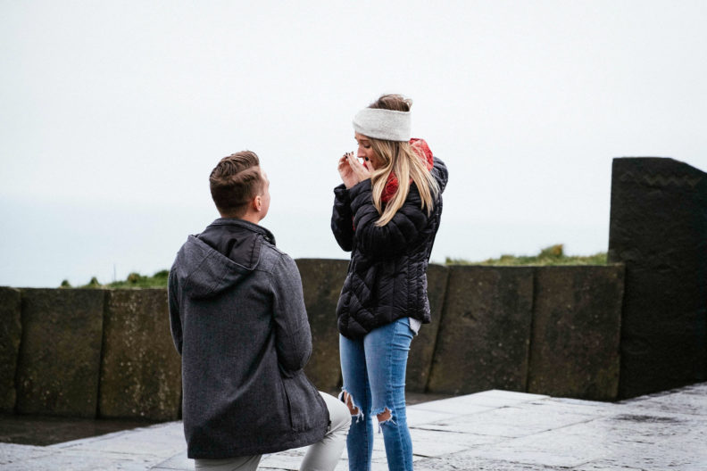 girls surprised reaction during engagement proposal at the cliffs of moher