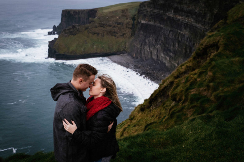 ewly engaged couple at the cliff edge at the cliffs of moher
