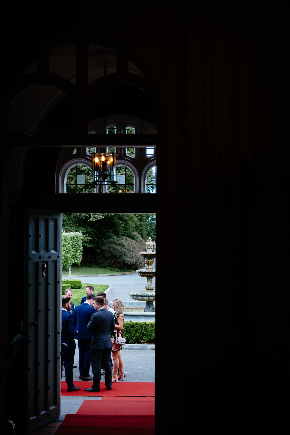 wedding guests outside doorway