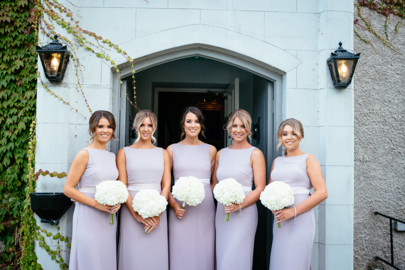 bridesmaids standing at front door of castle bellingham