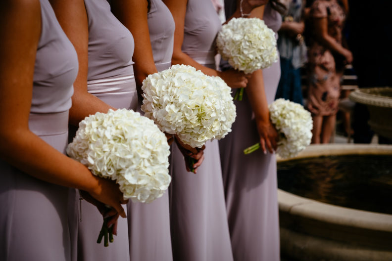 4 bridesmaids holding flowers