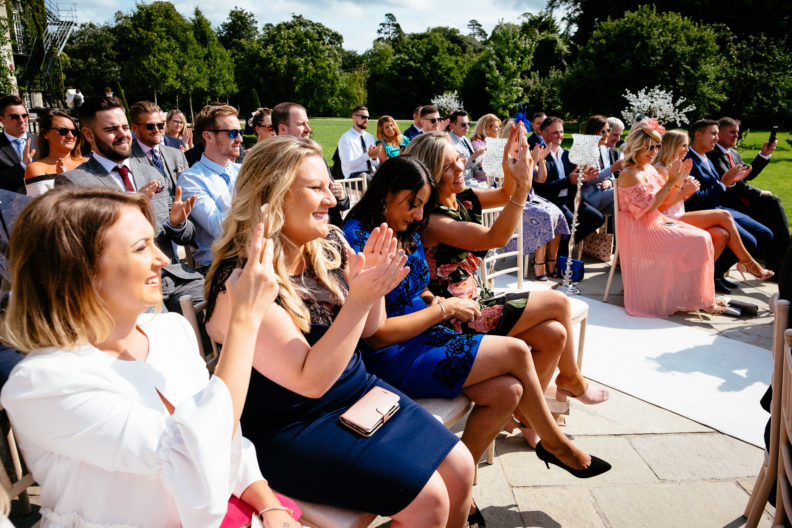 wedding guests clapping hands