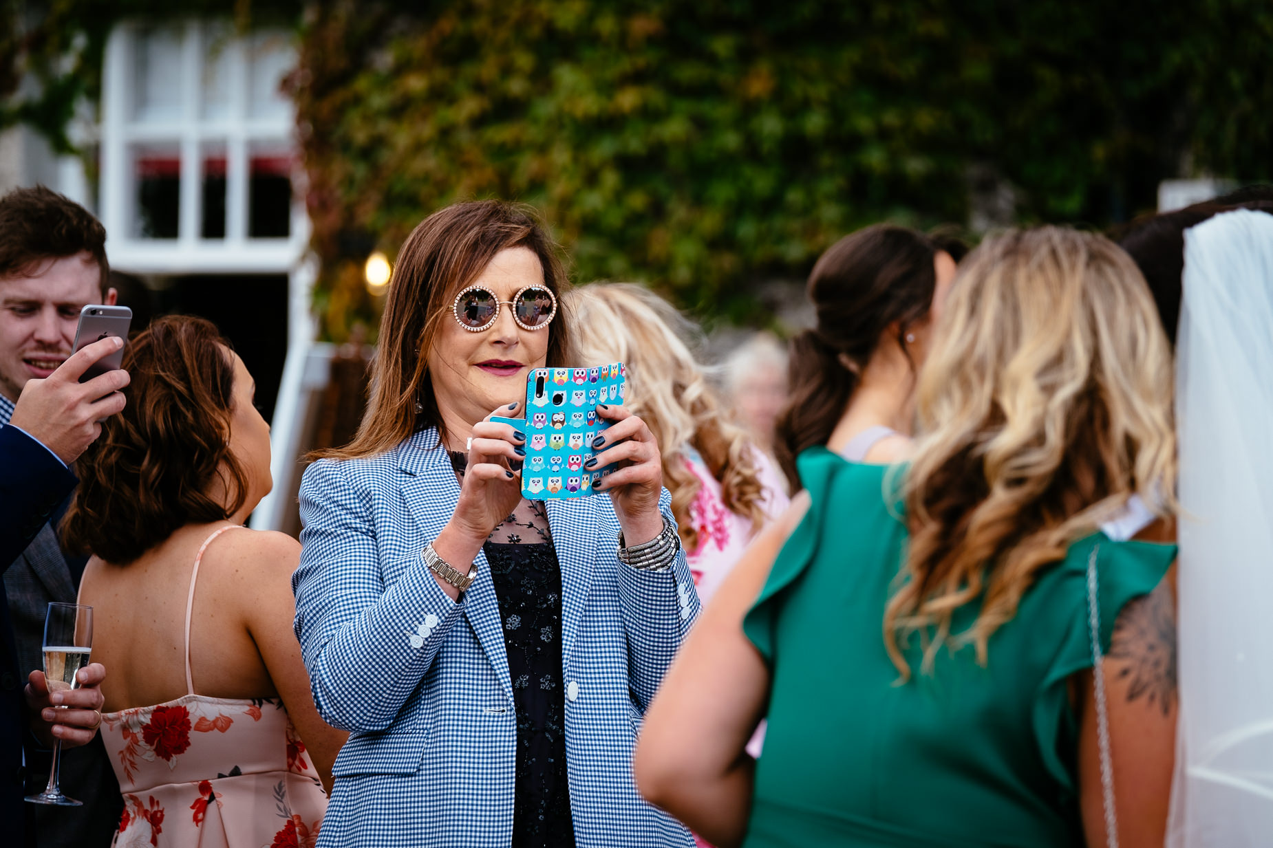 wedding guest taking photo with mobile phone