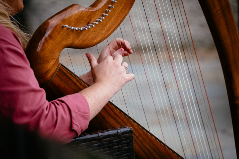 harpist playing harp