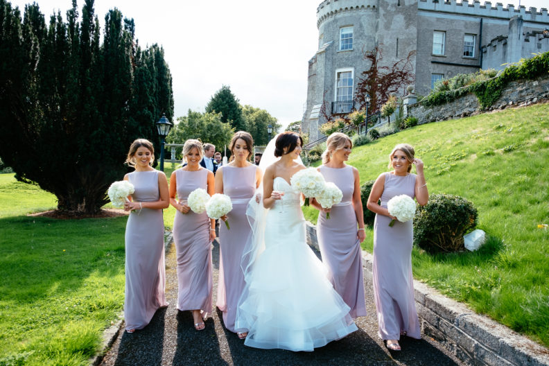 bride and bridesmaids walking and laughing