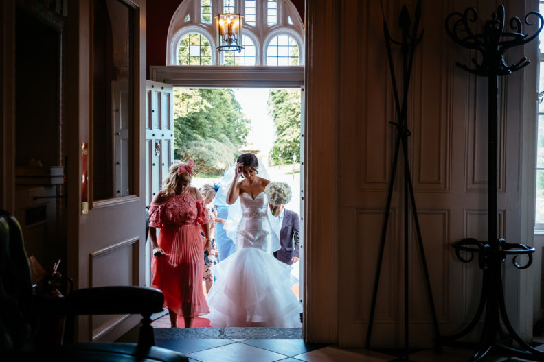 bride walking through castle doorway