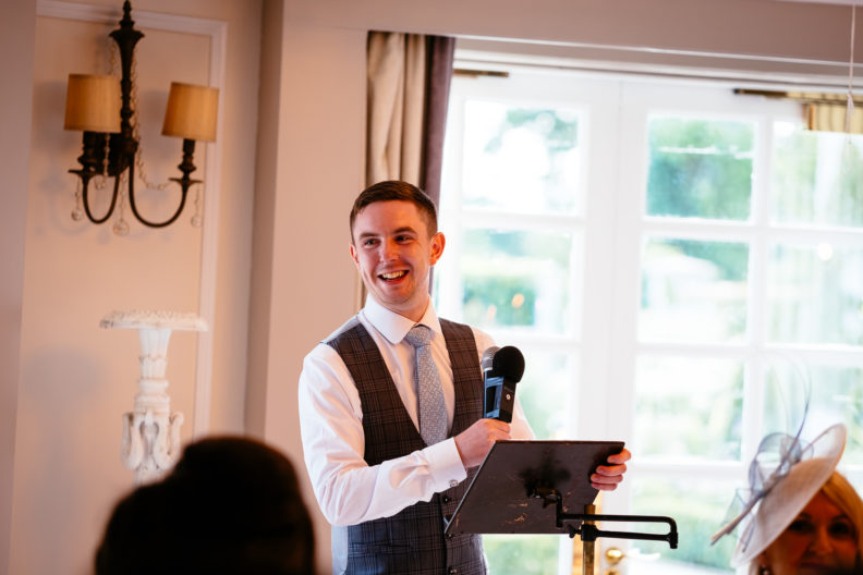 best man making a speech and laughing