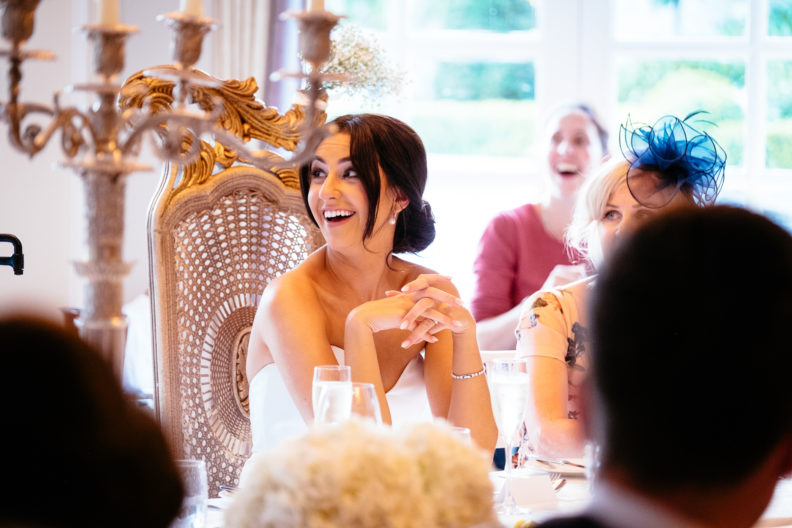 bride laughing during speeches