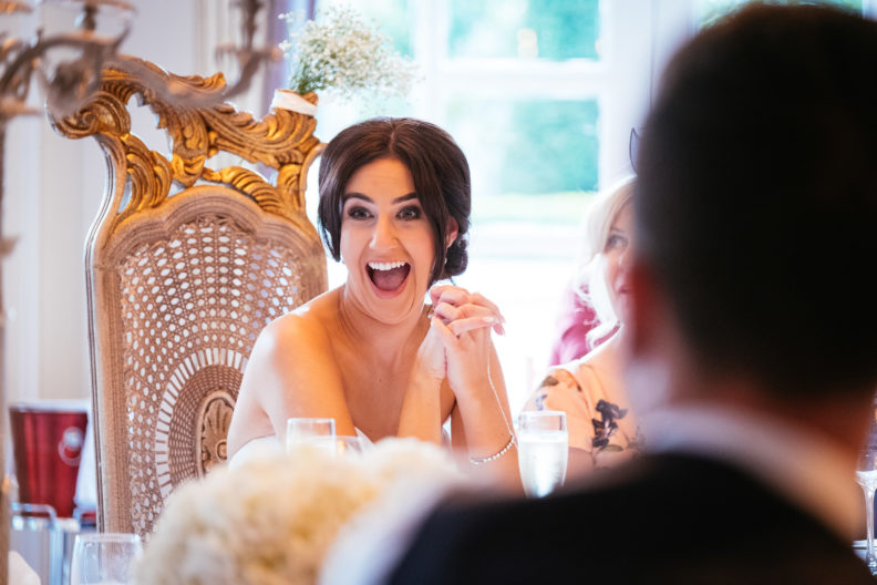 bride making a face during speeches