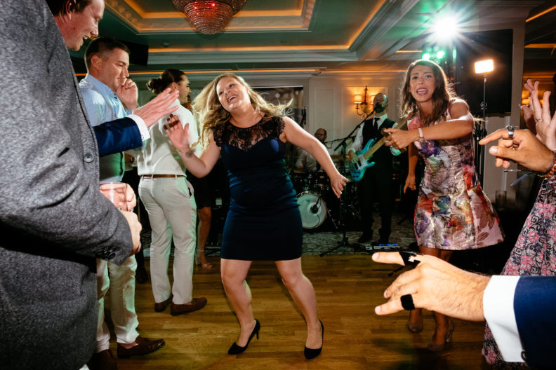 wedding guests dancing wildly on dance floor