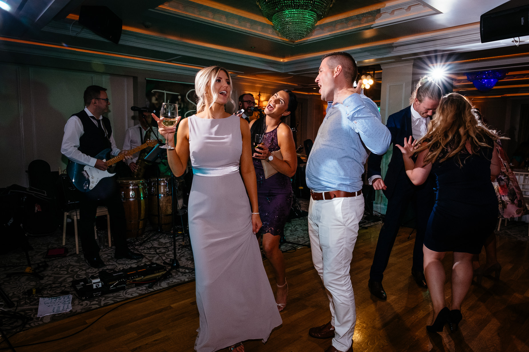wedding guests dancing on dance floor