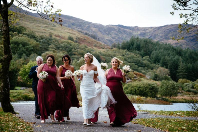 bride and bridesmaids walking up to Gougane Barra church