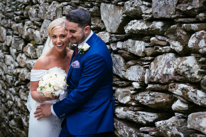 bride and groom embracing and laughing at Gougane Barra