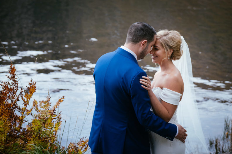 bride and groom touching foreheads at Gougane Barra