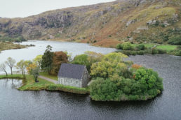 drone photograph of Gougane Barra church Cork Ireland