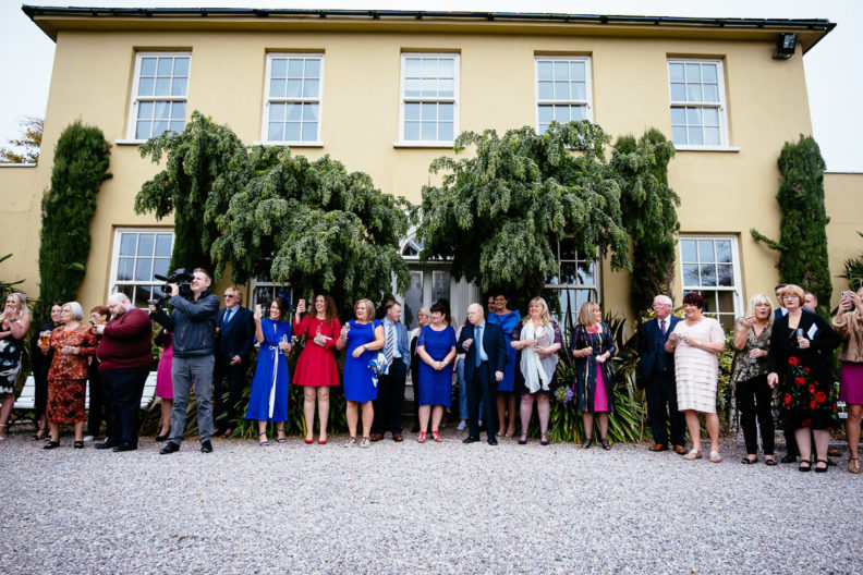 wedding guests waiting outside ballinacurra house