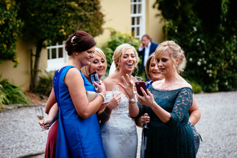 bride laughing with guests at ballinacurra house