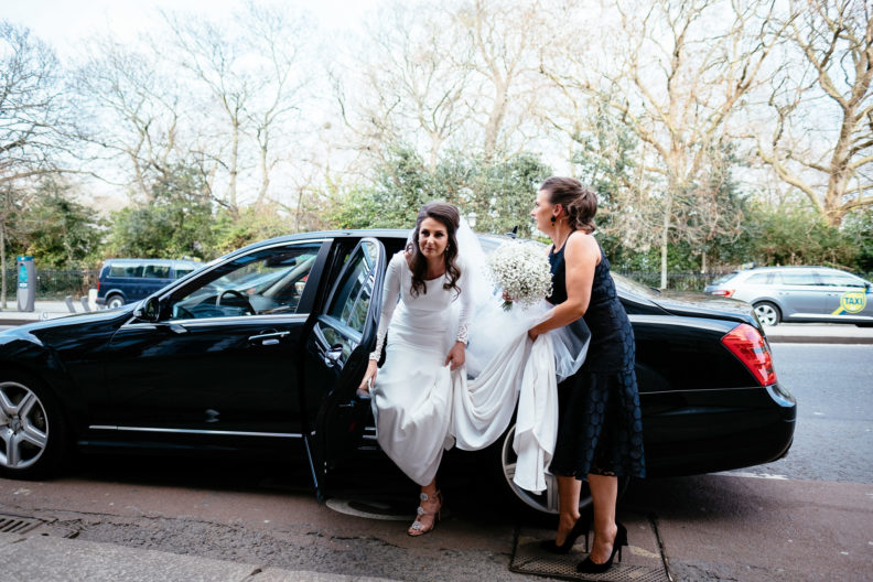 bride getting out of car at church