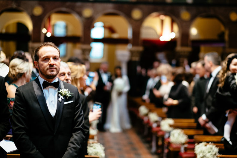 groom waiting for bride to walk up aisle