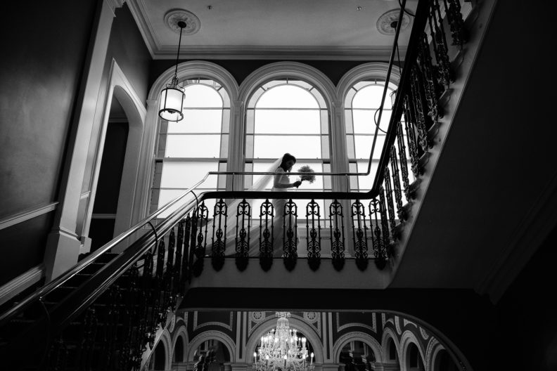 silhouette of a bride walking across landing of hotel