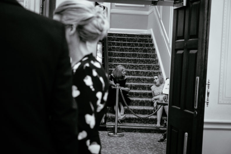 wedding guests sitting on stairs