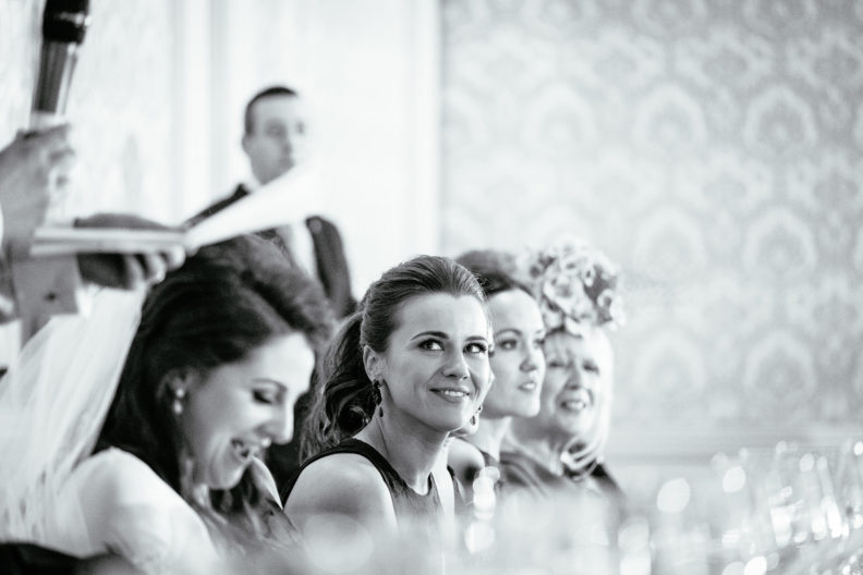bridesmaid looking at groom during his speech