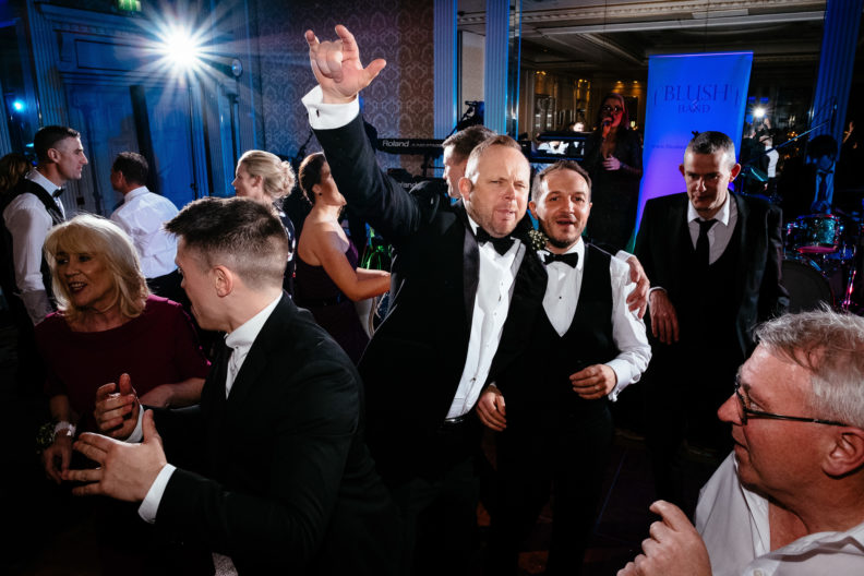 male guests dancing