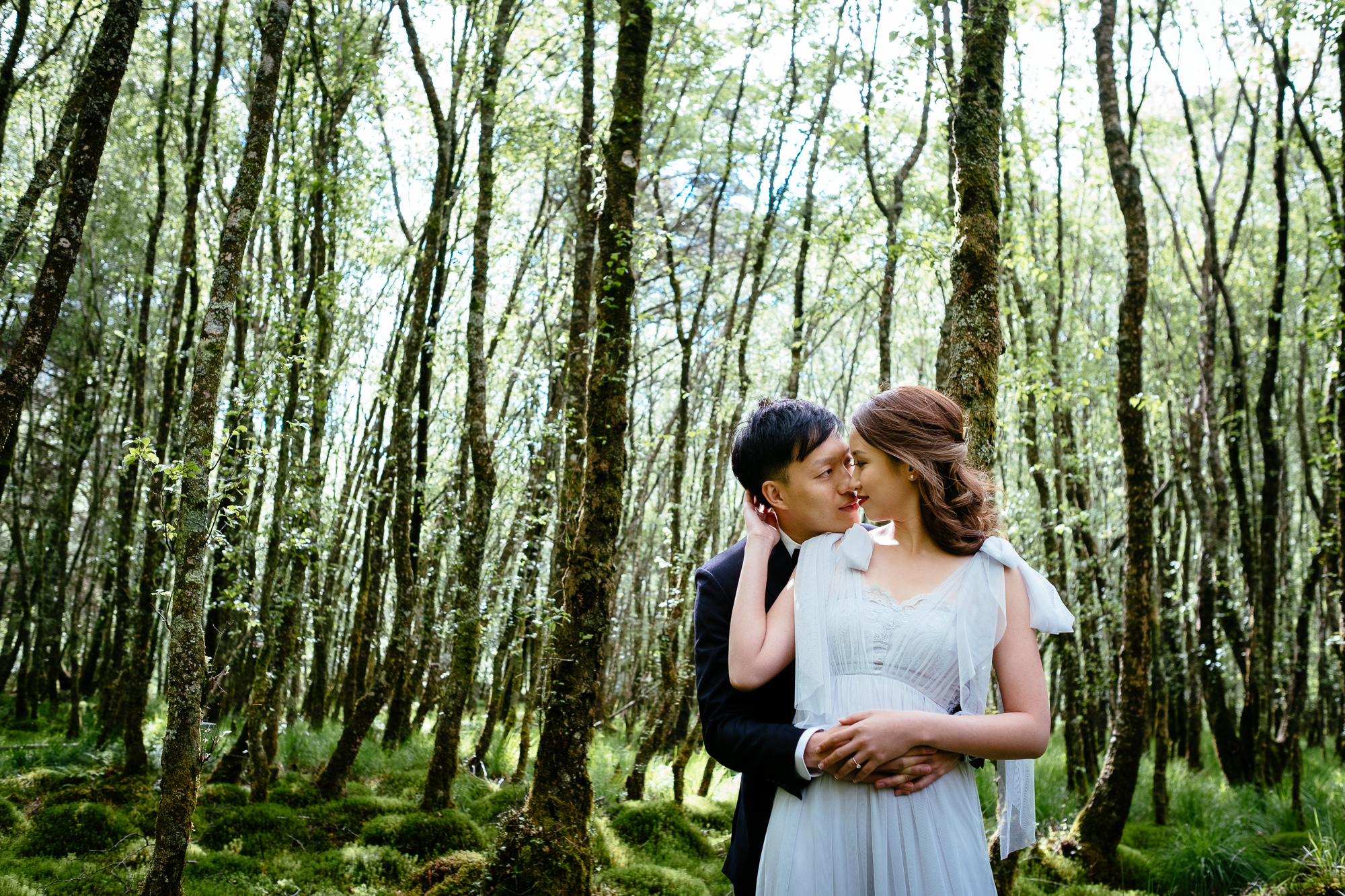 asian couple in a forest in Ireland