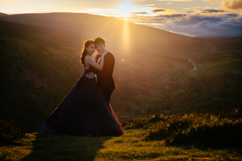 engaged couple at sunset in irish mountains
