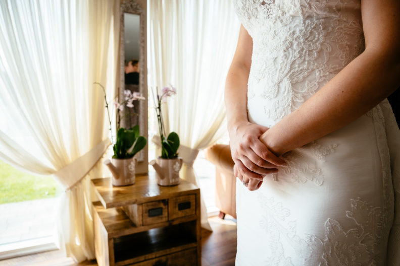 bride with her hands crossed on her lap