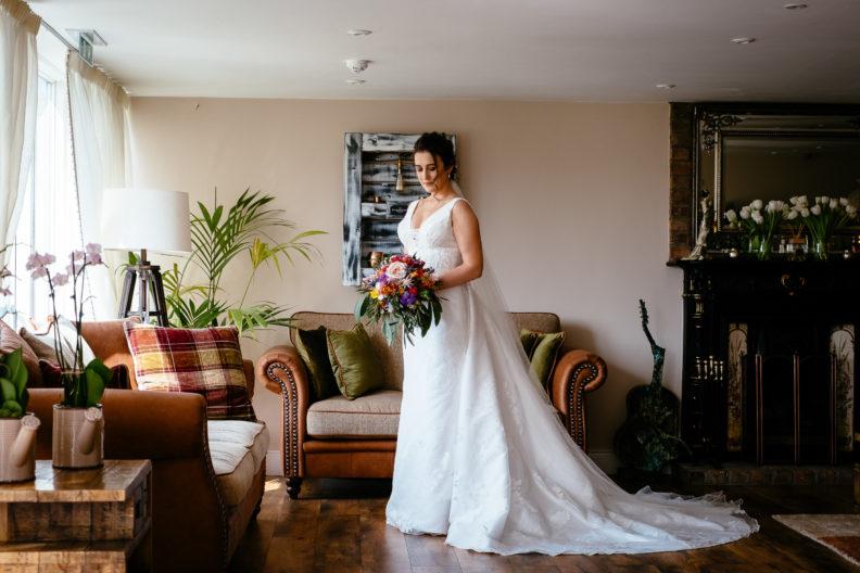 bride holding her flowers at ballymagarvey village