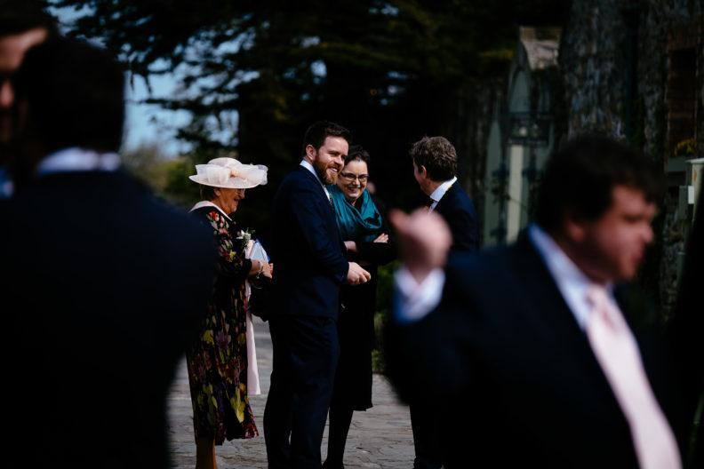 groom meeting his wedding guests