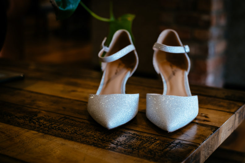 brides wedding shoes on a table