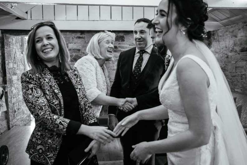 bride and groom being congratulated by guests